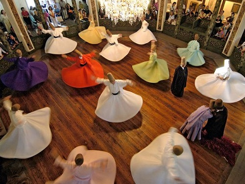 By Cenkko. 'Whirling Dervishes from Turkey. They belong to a Sufi Islamic sect called the Mevlevi founded by the famous philosopher Mevlana. Picture was taken from the top viewing gallery.' Via Wikimedia Commons: https://commons.wikimedia.org/wiki/File:Whirlingdervishes.JPG