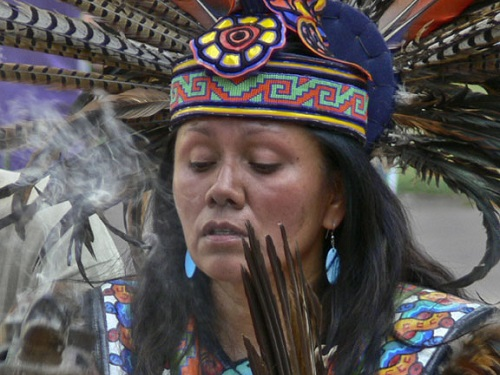 By Allen Sheffield. 'Shaman Woman 2' Cropped. Indian Market - Santa Fe, New Mexico 2007. Shaman performing a cleansing ceremony. https://www.flickr.com/photos/awsheffield/8574519977